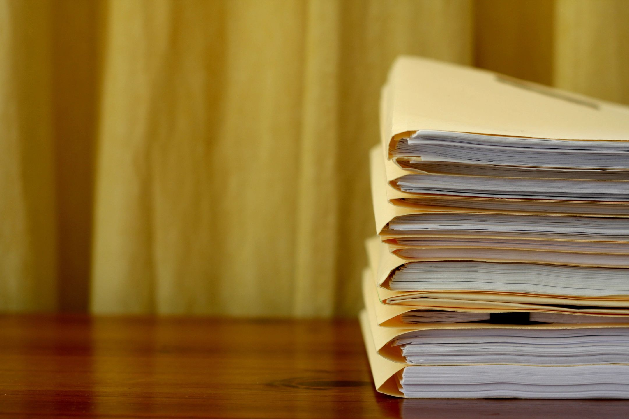 stack of workers comp papers